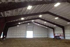 Finished spray foam insulation on red iron building