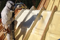 Certified applicator applying spray foam insulation