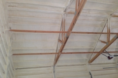 Shop ceiling with spray foam insulation
