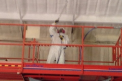 Spray foam contractor applying on steel building