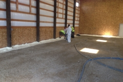 Working on spray foam insulation barrier