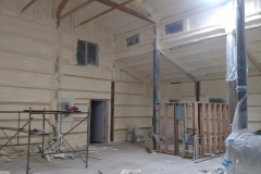 Spray foam insulation on commercial building