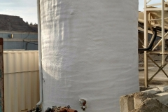 Spray foam insulation on water heater