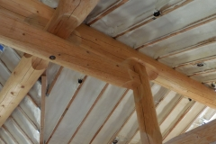 Spray foam insulation on log home