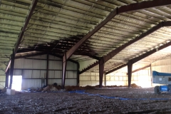 spray foam insulation on red iron steel building